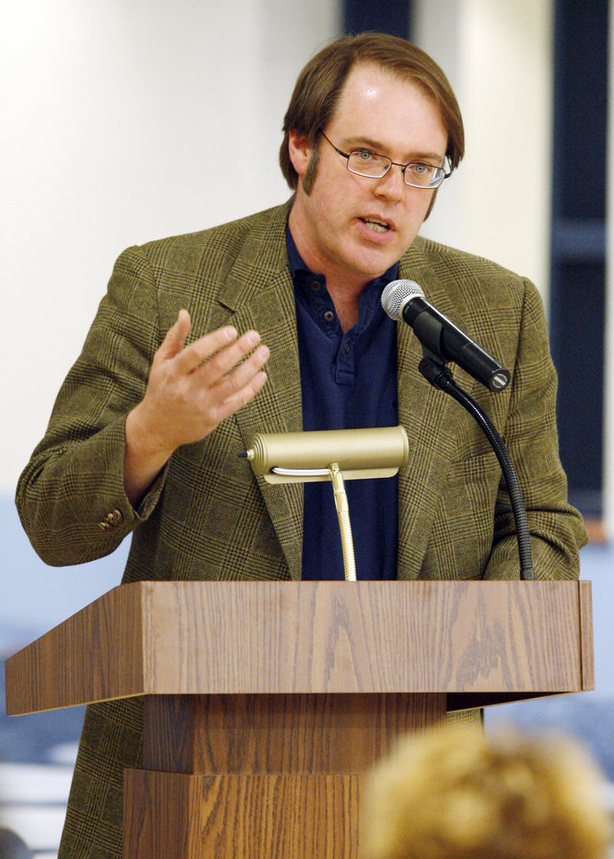 Photo - Chuck Thornton with the ACLU speaks during the Edmond Board of Education's Public Forum concerning the district's proposed new drug testing policy, at Edmond North High School in Edmond, Okla., February 9, 2009. BY NATE BILLINGS, THE OKLAHOMAN