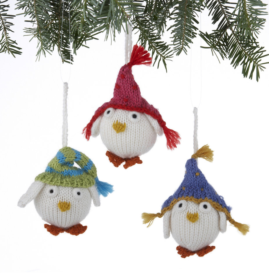 In this undated publicity image provided by Crate and Barrel, Alpaca Snowy Owl ornaments made of soft alpaca blend wool by rural Peruvian women are shown. Crate and Barrel collaborated on the collection with a fair trade group that helps the women earn money to support and sustain their families. (AP Photo/Crate and Barrel)