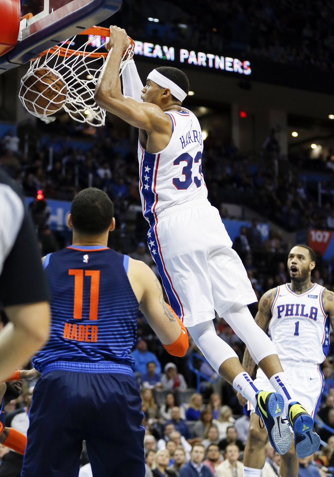 Photo - Philadelphia's Tobias Harris (33) dunks the ball in the third quarter next to Oklahoma City's Abdel Nader (11) during an NBA basketball game between the Philadelphia 76ers and the Oklahoma City Thunder at Chesapeake Energy Arena in Oklahoma City, Thursday, Feb. 28, 2019. Philadelphia won 108-104. Photo by Nate Billings, The Oklahoman