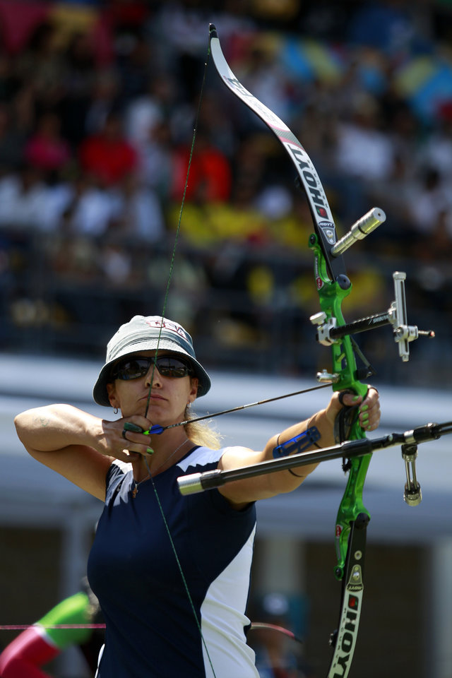 """Photo -   FILE - This Oct. 21, 2011 file photo shows Khatuna Lorig, of the United States, taking aim in the archery team final competition during the Pan American Games in Guadalajara, Mexico. The naturalized American, who called the sport """"cool,"""" gave actress Jennifer Lawrence one-hour lessons for 15 consecutive days before the movie """"The Hunger Games"""" began filming and the actor picked the technique up quickly. The movie has shined a bright light on the ancient sport of archery and fueled interest across the country to pick up a bow and arrow. (AP Photo/Dario Lopez-Mills, File)"""