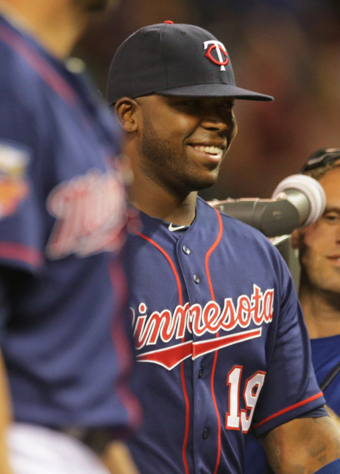 Photo - Minnesota Twins' Kennys Vargas smiles as he the team celebrates a 3-1 win over the San Diego Padres in a baseball game, Tuesday, Aug. 5, 2014, in Minneapolis. Vargas hit a three-run home run in the sixth inning. (AP Photo/Jim Mone)