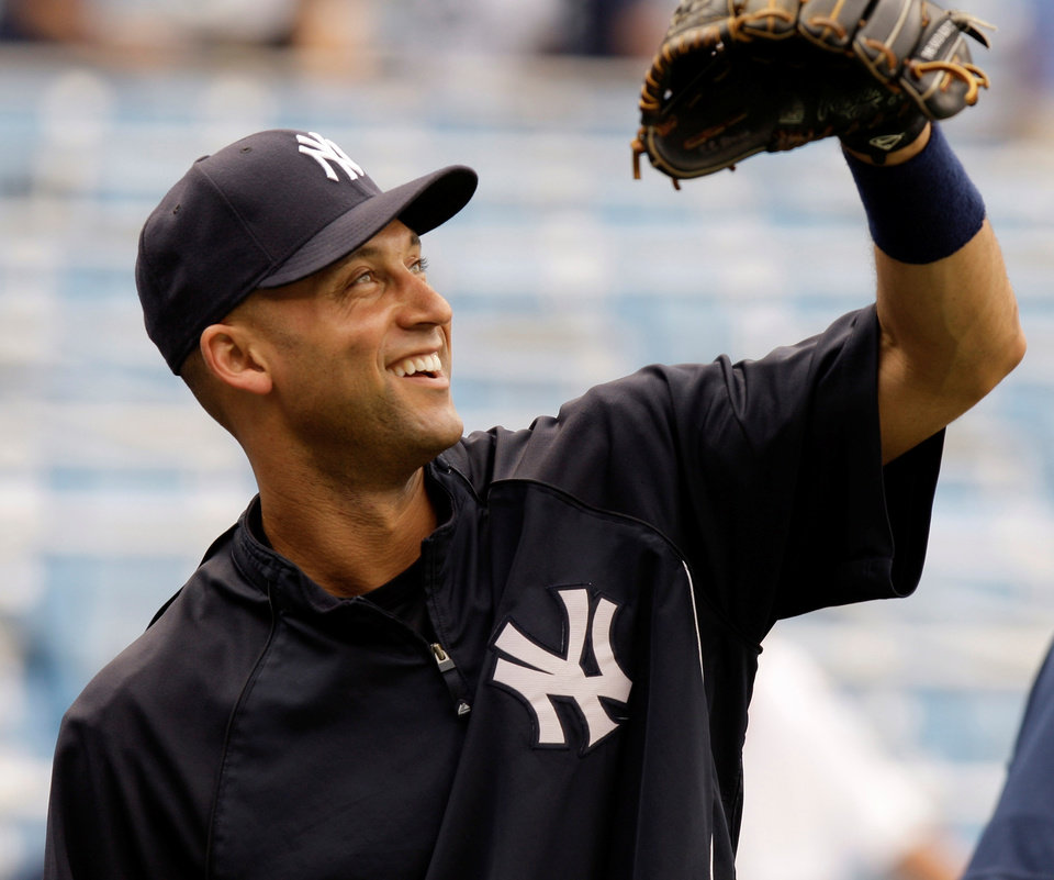 Photo - New York Yankees shortstop Derek Jeter waits to catch a ball before the Yankees face  the Boston Red Sox in a baseball game at Yankee Stadium in New York, Sunday, July 6, 2008. (AP Photo/Kathy Willens) ORG XMIT: NYY102