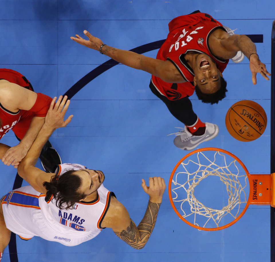 Photo - Toronto's DeMar DeRozan (10) puts up a shot beside Oklahoma City's Steven Adams during Wednesday night's game at Chesapeake Energy Arena. The Thunder lost, 103-98. (Photo by Bryan Terry, The Oklahoman)