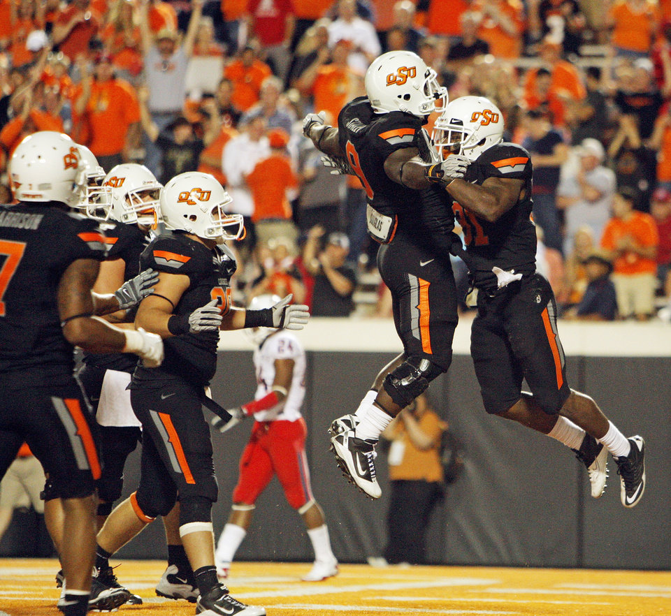 Photo - Oklahoma State's Jeremy Smith, right, jumps in the air with Kye Staley to celebrate a touchdown by Smith in the fourth quarter  during the Cowboys 37-14 win over Arizonaon Thursday in Stillwater. PHOTO BY NATE BILLINGS, The Oklahoman