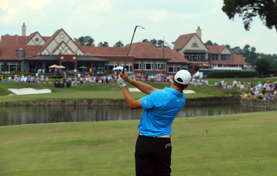 Photo - Corey Conners, of Canada, hits his third shot to the 18th green during the 2014 U.S. Amateur Championship at Atlanta Athletic Club on Sunday, Aug. 17, 2014, in Johns Creek, Ga. (AP Photo/Atlanta Journal-Constitution, Curtis Compton)  MARIETTA DAILY OUT; GWINNETT DAILY POST OUT; LOCAL TV OUT; WXIA-TV OUT; WGCL-TV OUT