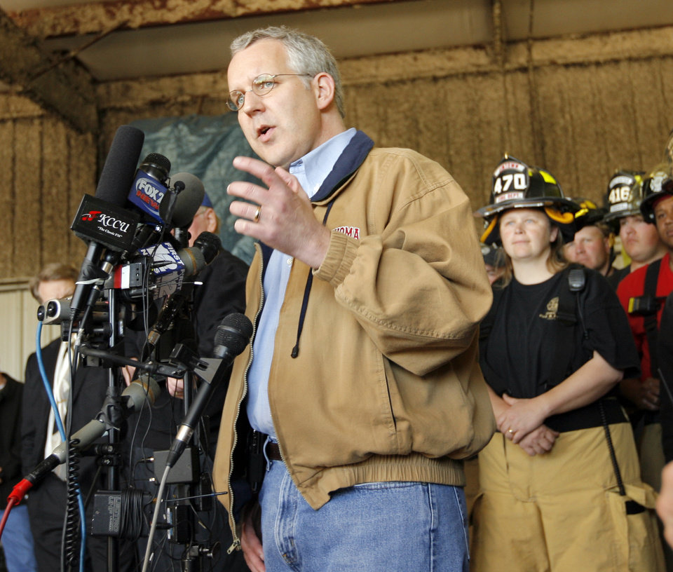 Photo - Gov. Brad Henry gives a news conference surrounded by first responders at the Lone Grove Fire Station No. 1 in Lone Grove, Okla., Wednesday, February 11, 2009. On Tuesday, February 10, 2009, a tornado moved through Lone Grove killing at least eight people. BY NATE BILLINGS, THE OKLAHOMAN