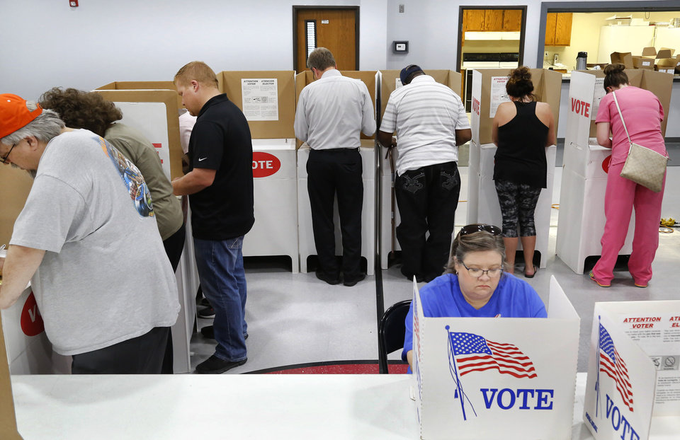 Photo - Oklahoma voters cast ballots in June 2018. [The Oklahoman archives]
