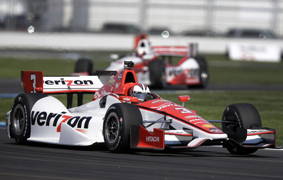 Photo - Helio Castroneves, of Brazil, leads teammate Juan Pablo Montoya, of Colombia, through turn 7 during practice for the inaugural Grand Prix of Indianapolis IndyCar auto race at the Indianapolis Motor Speedway in Indianapolis, Thursday, May 8, 2014. (AP Photo/Michael Conroy)