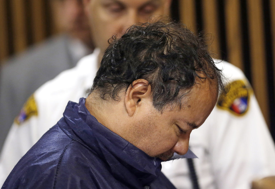 Photo - Ariel Castro appears in Cleveland Municipal court Thursday, May 9, 2013, in Cleveland. Castro was charged with four counts of kidnapping and three counts of rape.   Ariel Castro was charged while his brothers, Pedro and Onil Castro, were held but faced no immediate charges. (AP Photo/Tony Dejak)
