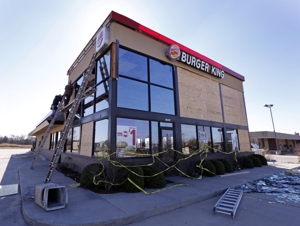 Photo - Damage from Wednesday's tornadoes is shown at a Burger King Restaurant at SW 119th and Western on Thursday, March 26, 2015 in Moore, Okla. Photo by Steve Sisney, The Oklahoman