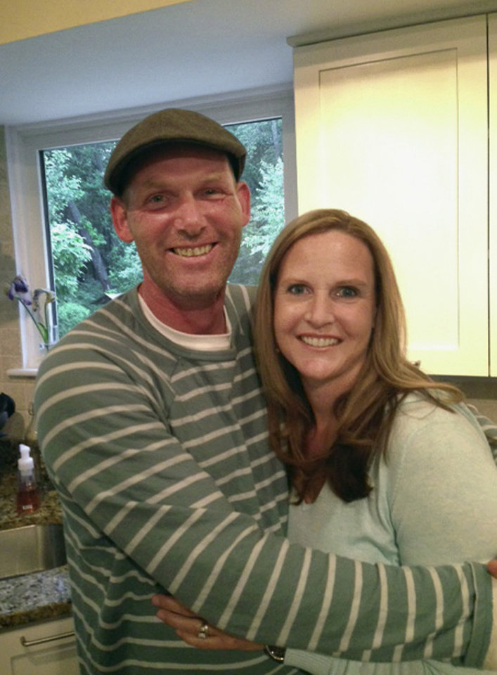 "Photo - This undated photo provided by the family shows co-pilot Bauke ""Mike"" de Vries with his wife Shelly.  De Vries, 45, of Marlton, New Jersey, was the co-pilot when a plane plunged down and erupted in flames during a takeoff attempt at Hanscom Field on Saturday, May 31, 2014, in Bedford, Mass. Lewis Katz, co-owner of The Philadelphia Inquirer, and six other people died in the crash.  (AP Photo/De Vries Family)"