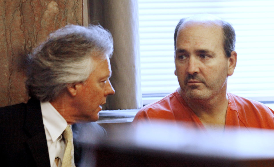 Photo - DR. STEPHEN WOLF: Attorney Mack Martin, left, talks with his client Dr. Stephen Paul Wolf who waived his preliminary hearing before Special Judge Larry Jones at the Oklahoma County Courthouse in Oklahoma City Friday, June 18, 2010. Wolf is charged with the stabbing death of his 9-year-old son. Photo by Paul B. Southerland, The Oklahoman ORG XMIT: KOD