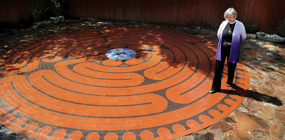 Photo -  The Rev. Susan Joplin, a canon at St. Paul's Episcopal Cathedral, walks the labyrinth she helped design for the YWCA's Passageways Shelter in Oklahoma City. Photo by Jim Beckel, The Oklahoman   Jim Beckel