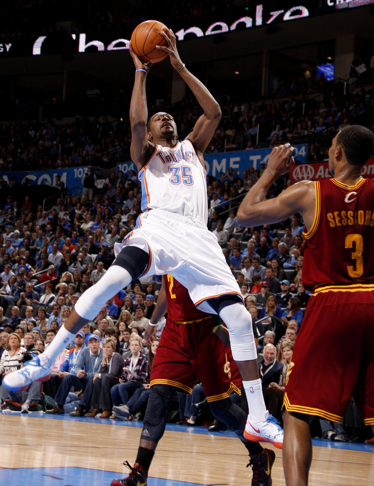 Photo - Oklahoma City's Kevin Durant (35) tries to get a shot off during the NBA basketball game between the Oklahoma City Thunder and the Cleveland Cavaliers at Chesapeake Energy Arena in Oklahoma City, Friday, March 9, 2012. Photo by Bryan Terry, The Oklahoman