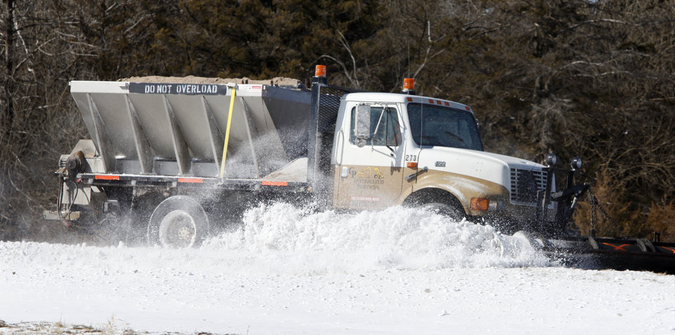 Photo - A snow plow clears an area of highway 152 and SW 74th in Oklahoma City , February  10 , 2011. Photo by Steve Gooch, The Oklahoman