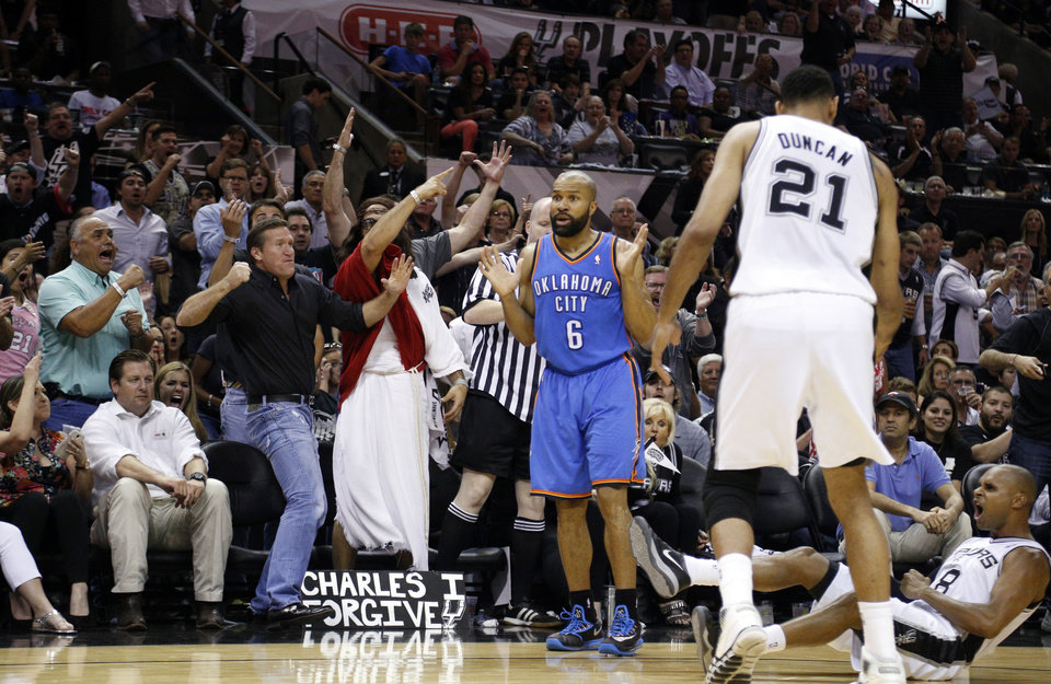 Photo - Oklahoma City's Derek Fisher (6) reacts after he is called for a foul of San Antonio's Patty Mills (8) during Game 5 of the Western Conference Finals in the NBA playoffs between the Oklahoma City Thunder and the San Antonio Spurs at the AT&T Center in San Antonio, Thursday, May 29, 2014. Photo by Sarah Phipps, The Oklahoman