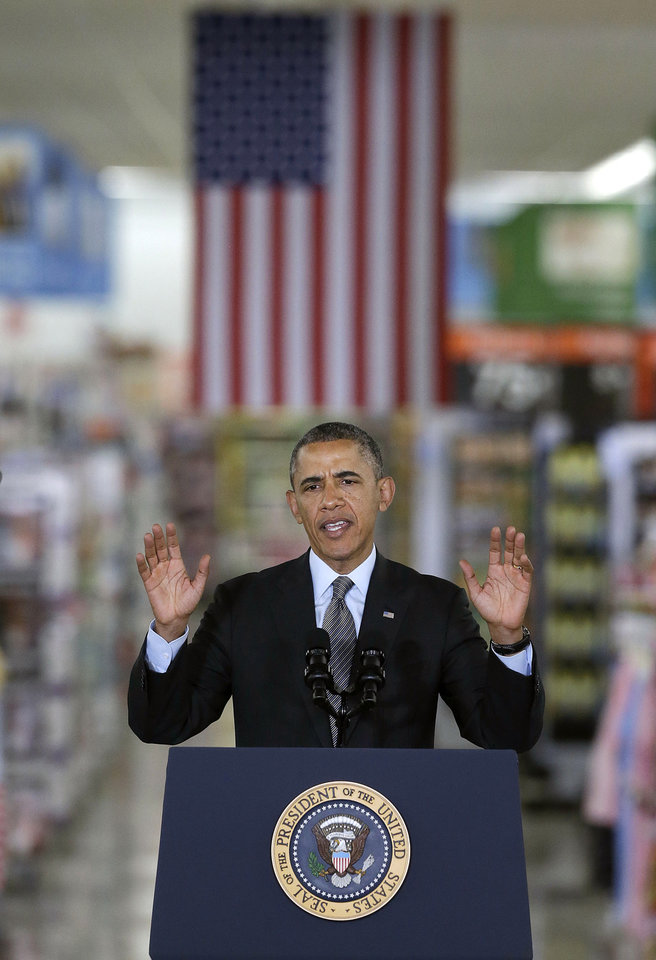 Photo - President Barack Obama speaks at a Walmart store in Mountain View, Calif., Friday, May 9, 2014. Obama announced new steps by companies, local governments and his own administration to deploy solar technology, showcasing steps to combat climate change that don't require consent from a disinclined Congress. (AP Photo/Jeff Chiu)