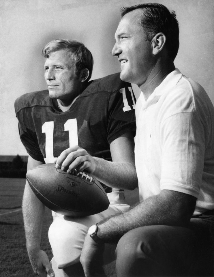 "Much-heralded sophomore quarterback Jack Mildren (left) poses with University of Oklahoma football coach Chuck Fairbanks as the Oklahoma Sooners held their annual ""Photo Day"" Thursday for the press. Staff photo by Jim Argo taken 8/28/1969; photo ran in the 8/29/1969 Daily Oklahoman."