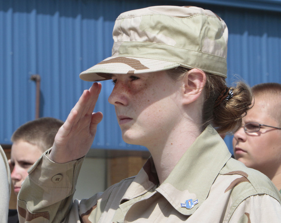 Alicia Lally salutes during a drill with Choctaw High School Air Force  Junior  ROTC  squad. Photo By David McDaniel, The Oklahoman