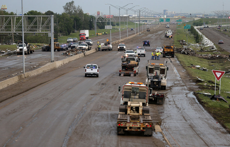 Crews work to clear I-35 after it was damaged by a tornado in Moore, Okla., after a tornado moved through the area on Monday, May 20, 2013. Photo by Bryan Terry, The Oklahoman