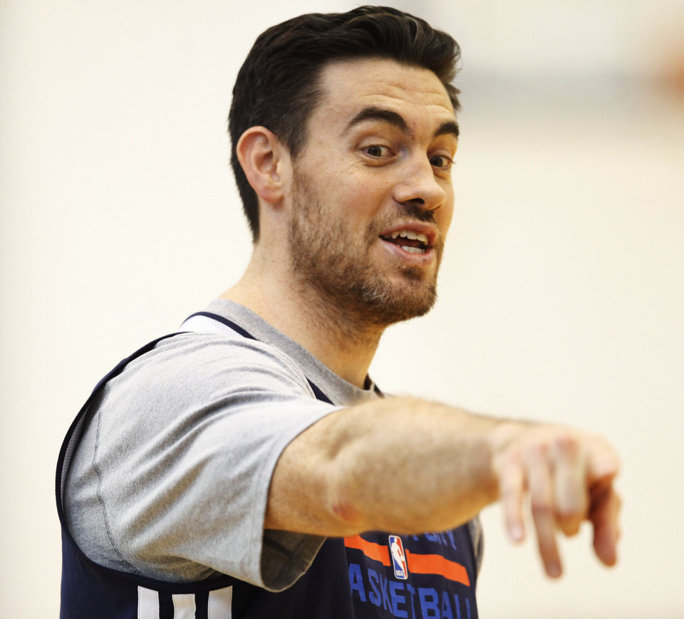 Photo - Thunder forward Nick Collison points a spot on the court out at after practice at the Thunder Practice Facility in Oklahoma City on Monday, April 26, 2014. Photo by KT King/The Oklahoman