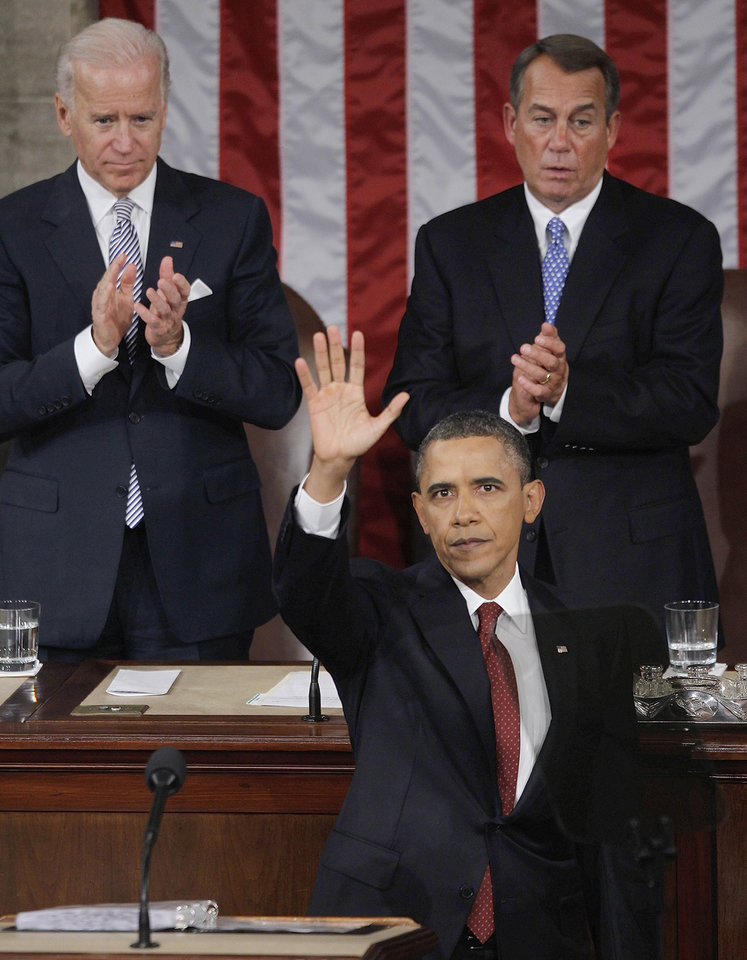 Photo - President Barack Obama waves after delivering the the State of the Union address in the U.S. Capitol in Washington, Tuesday, Jan. 24, 2012. Vice President Joe Biden, left, and House Speaker John Boehner of Ohio applaud in the background. (AP Photo/Pablo Martinez Monsivais) ORG XMIT: CAP205