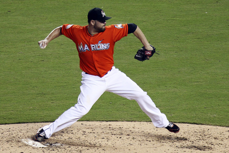 Photo -   Miami Marlins starter Ricky Nolasco pitches to the Milwaukee Brewers during the fourth inning of a baseball game in Miami, Monday, Sept. 3, 2012. (AP Photo/J Pat Carter)