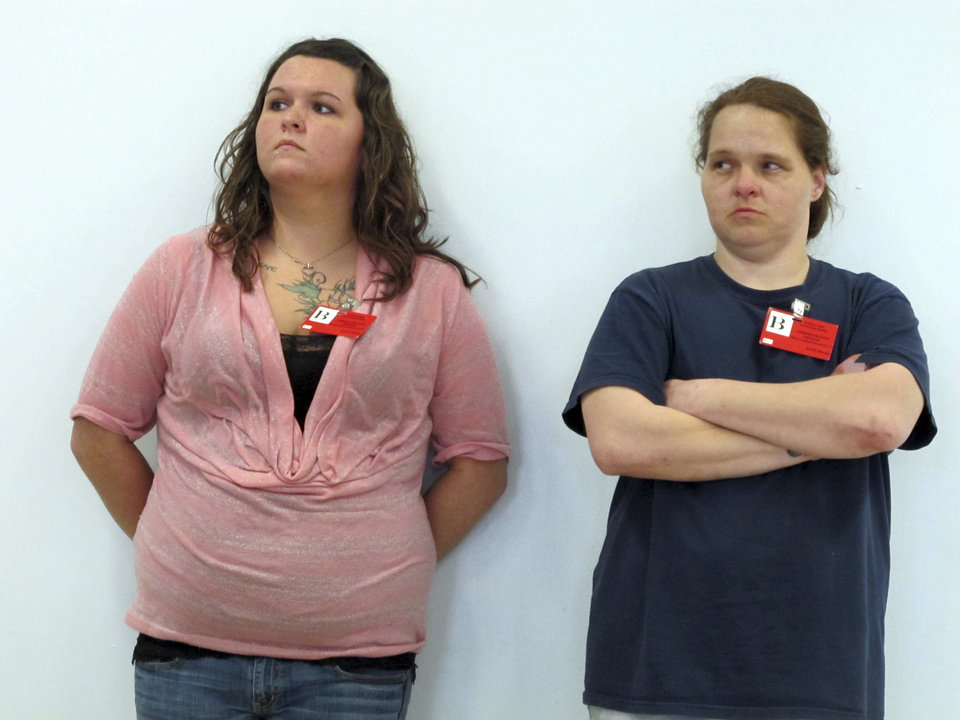 Kaylee Bashline, left, and Kesha Frye stand inside the Ohio state prison in Lucasville, Ohio following the execution of Steve Smith Wednesday, May 1, 2013. Smith was convicted and sentenced to death for killing Frye's six-month-old daughter while raping her in 1998. (AP Photo/Amanda Lee Myers)