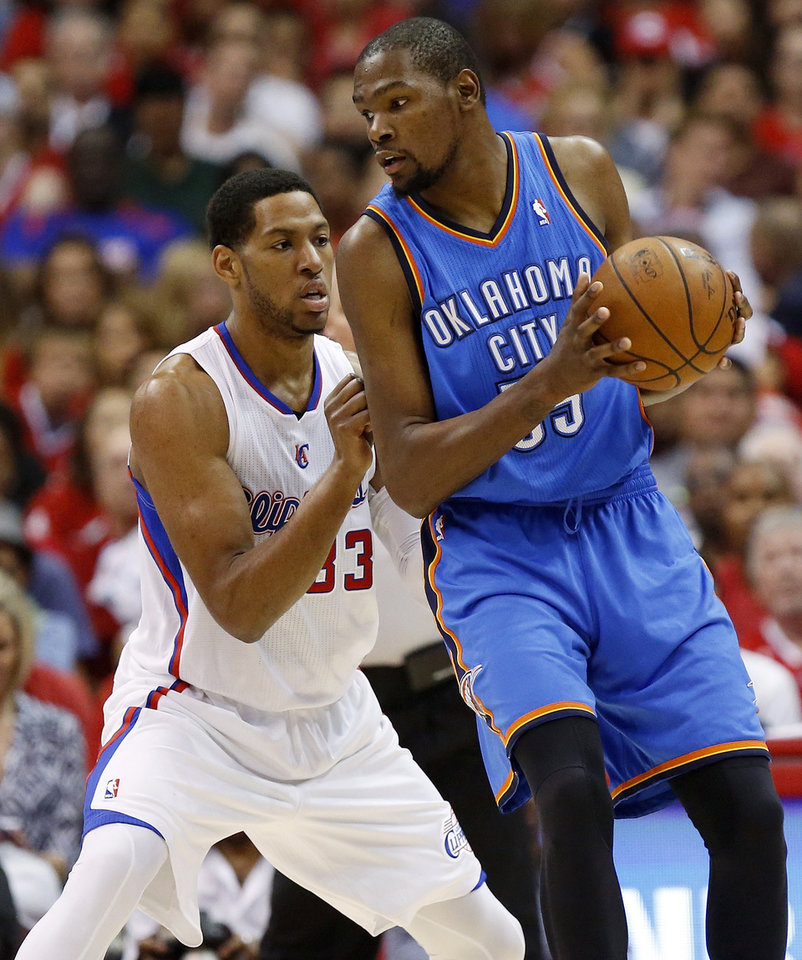 Photo - Oklahoma City's Kevin Durant (35) works against Los Angeles' Danny Granger (33) during Game 4 of the Western Conference semifinals in the NBA playoffs between the Oklahoma City Thunder and the Los Angeles Clippers at the Staples Center in Los Angeles, Sunday, May 11, 2014. Photo by Nate Billings, The Oklahoman
