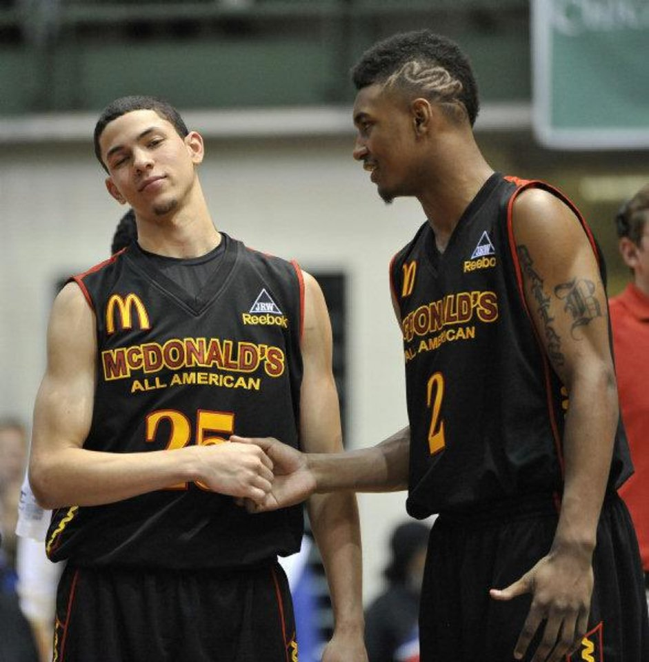 Photo - Oklahoma State signee LeBryan Nash, right, talks with Austin Rivers during the slam dunk contest at the McDonald's High School All American basketball Jam Fest at Chicago State University in Chicago, Monday, March 28, 2011. (AP Photo/Brian Kersey)