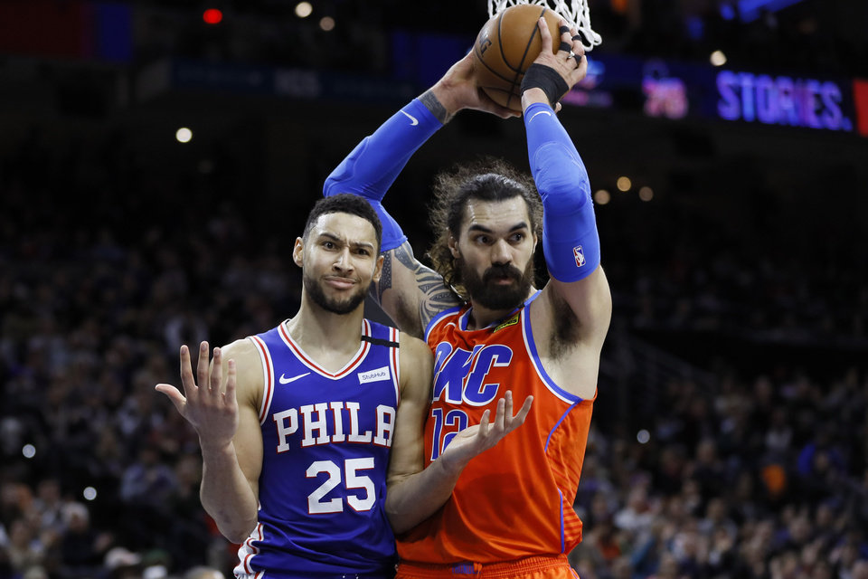 Photo - Philadelphia 76ers' Ben Simmons, left, reacts after making a basket and not getting a foul call past Oklahoma City Thunder's Steven Adams from an official during the second half of an NBA basketball game, Monday, Jan. 6, 2020, in Philadelphia. (AP Photo/Matt Slocum)