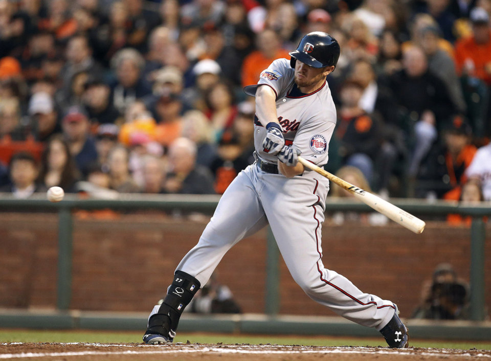 Photo - Minnesota Twins' Chris Parmelee drives in a run against the San Francisco Giants in the third inning of a baseball game Friday, May 23, 2014, in San Francisco. (AP Photo/Tony Avelar)