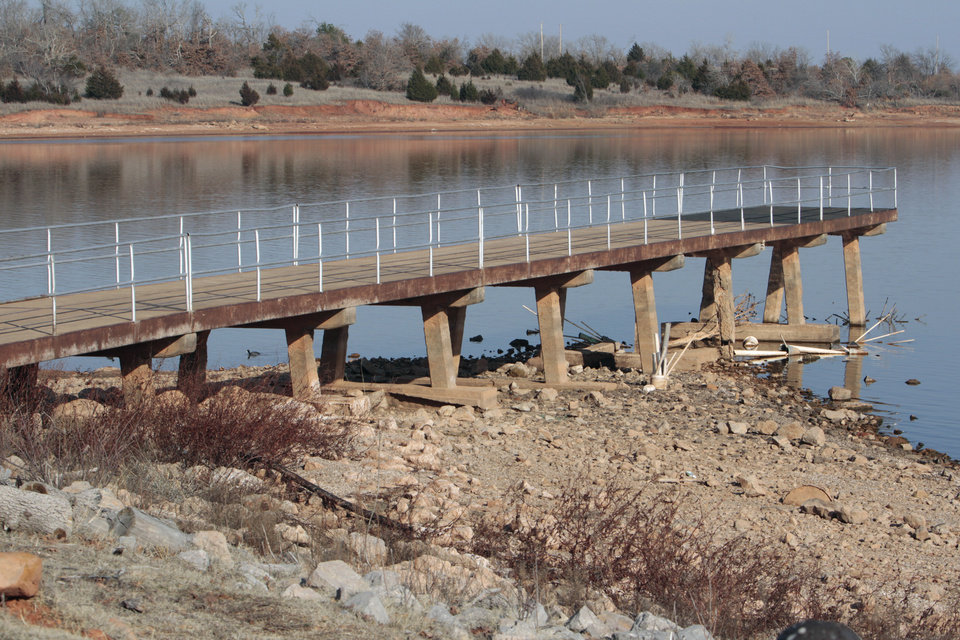 A fishing pier shows that water level at Lake Thunderbird is very low on Thursday, Feb. 16, 2012, in Norman, Okla.   Photo by Steve Sisney, The Oklahoman