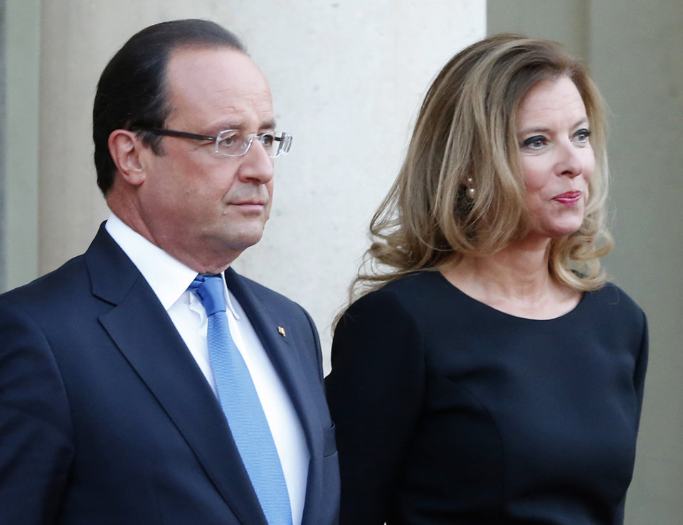 Photo - FILE - In this Sept. 3, 2013 file photo, French president Francois Hollande and his companion Valerie Trierweiler wait for German President Joachim Gauckand, at the  Elysee Palace, in Paris. The magazine Closer published images Friday Jan. 10, 2014 showing his bodyguard and a helmeted man it says is Hollande visiting what it says is the apartment of the actress. Hollande is threatening legal action over magazine report saying he is having a secret affair with a French actress. (AP Photo/Jacques Brinon, File)