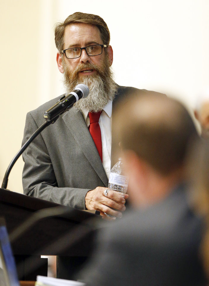 Photo - Chris Moe with Green the Vote answers a question during the first meeting of the Medical Marijuana Working Group in room 535 of the state Capitol in Oklahoma City, Wednesday, July 25, 2018. Photo by Nate Billings, The Oklahoman