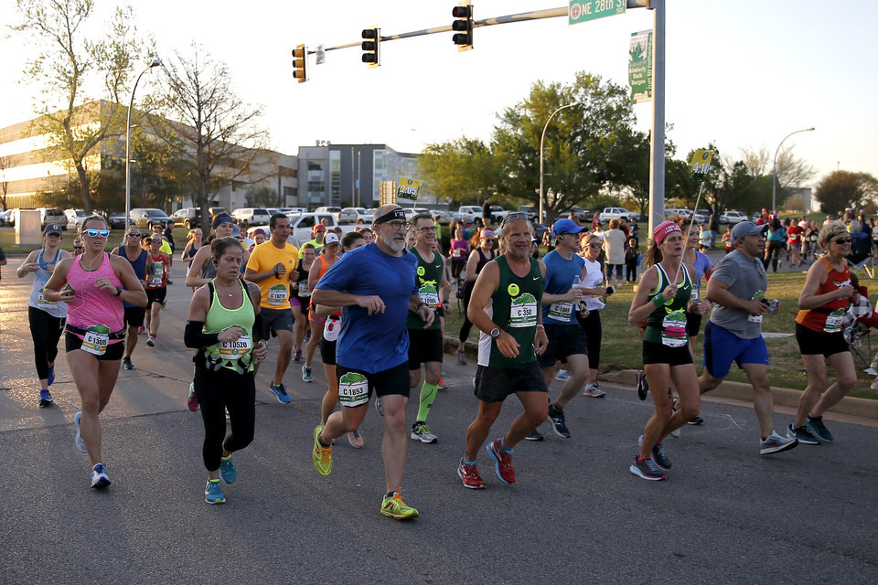 Photo - Runners turn west on NE 28th Street from Lincoln Blvd. during the Oklahoma City Memorial Marathon in Oklahoma City, Sunday, April 29, 2018. Photo by Bryan Terry, The Oklahoman