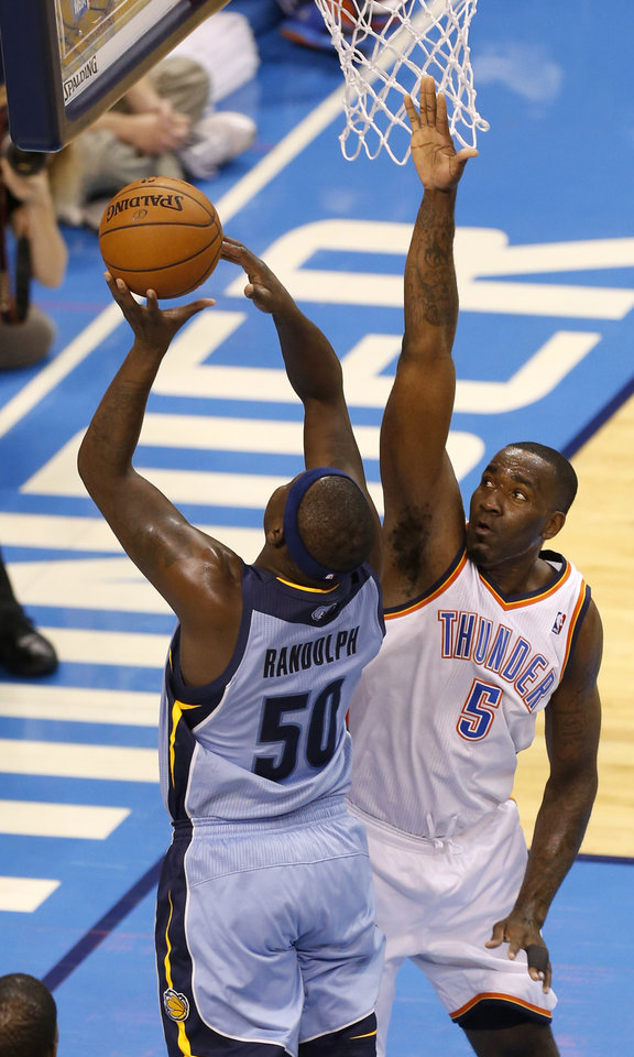 Photo - Oklahoma City's Kendrick Perkins (5) defends Memphis' Zach Randolph (50) during Game 5 in the first round of the NBA playoffs between the Oklahoma City Thunder and the Memphis Grizzlies at Chesapeake Energy Arena in Oklahoma City, Tuesday, April 29, 2014. Photo by Nate Billings, The Oklahoman