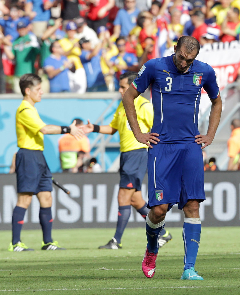 Photo - Italy's Giorgio Chiellini bows his head after the group D World Cup soccer match between Italy and Costa Rica at the Arena Pernambuco in Recife, Brazil, Friday, June 20, 2014. Costa Rica won the match 1-0.   (AP Photo/Antonio Calanni)