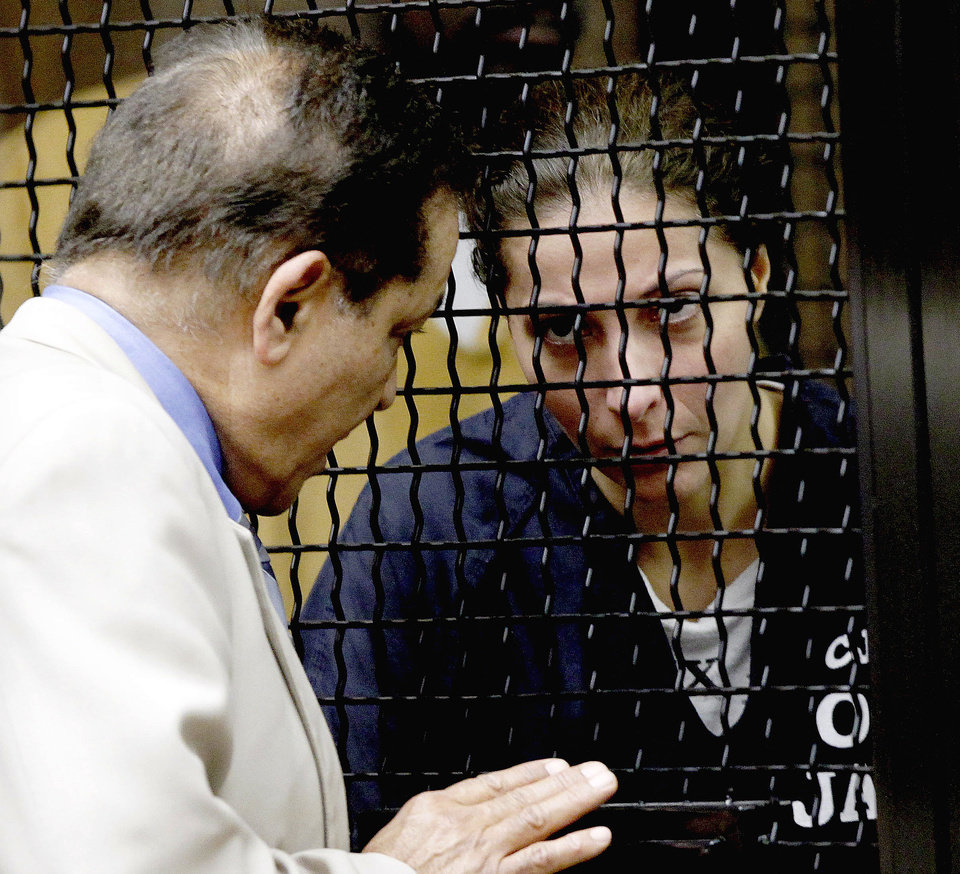 Photo - Saudi princess Meshael Alayban, right, listens to an interpreter during her scheduled appearance in court Thursday July 11, 2013 in Santa Ana, Calif. Alayban appeared in Orange County Superior Court Thursday but her arraignment was delayed to July 29 at the request of her attorney. Alayban, 42, was charged Wednesday with human trafficking and accused of holding a domestic worker from Kenya against her will. (AP Photo/Nick Ut)