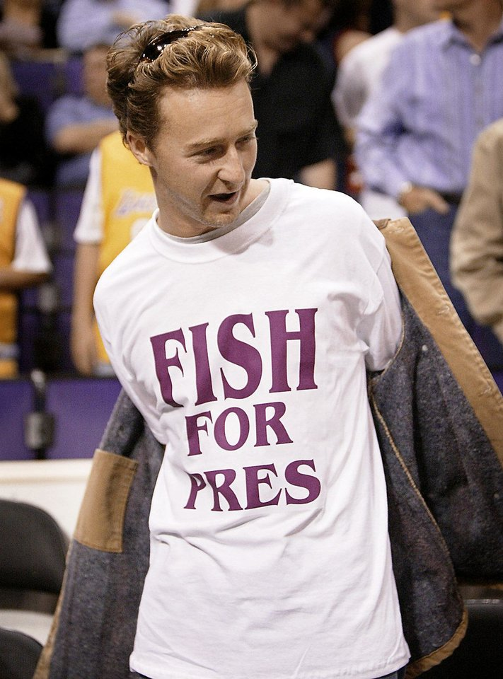 Photo - Actor Edward Norton wears a t-shirt supporting Los Angeles Lakers guard Derek Fisher before the start of Game 6 of the Lakers' NBA Western Conference semifinal game against the San Antonio Spurs in Los Angeles, Saturday, May 15, 2004. Fisher's Game 5 buzzer beater won the game for the Lakers. (AP Photo/Kevork Djansezian)