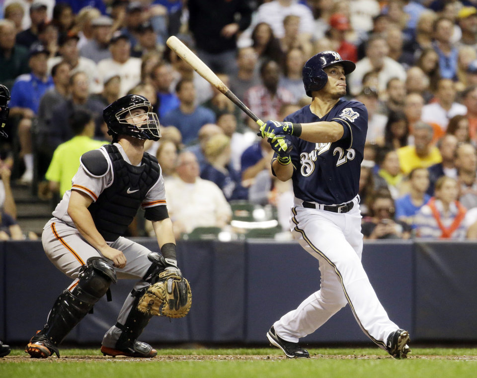 Photo - Milwaukee Brewers' Gerardo Parra hits a home run during the seventh inning of a baseball game against the San Francisco Giants Tuesday, Aug. 5, 2014, in Milwaukee. (AP Photo/Morry Gash)