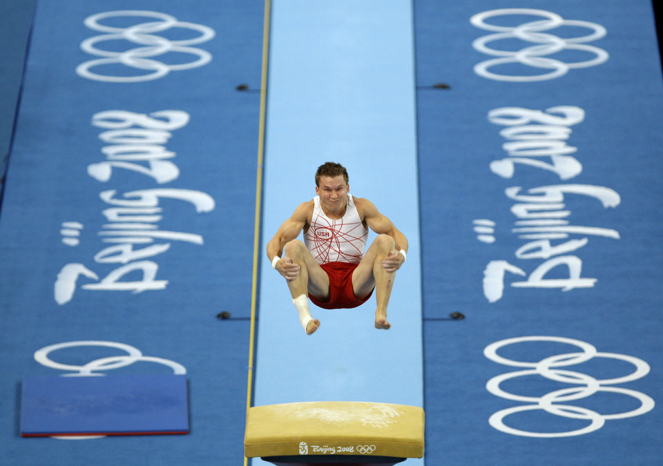 Photo - GYMNASTICS: Jonathan Horton performs at the men's vault during a podium training at the Beijing 2008 Olympics in Beijing, Wednesday, Aug. 6, 2008.  (AP Photo/Odd Andersen) ORG XMIT: OLYGY111