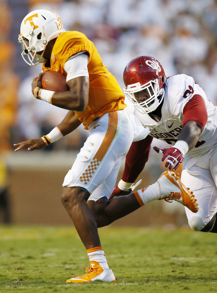 Photo - Oklahoma's Charles Tapper (91) pursues Tennessee's Joshua Dobbs (11) during the college football game between the Oklahoma Sooners (OU) and the Tennessee Volunteers at Neyland Stadium in Knoxville, Tennessee, Saturday, Sept. 12, 2015. Photo by Nate Billings, The Oklahoman