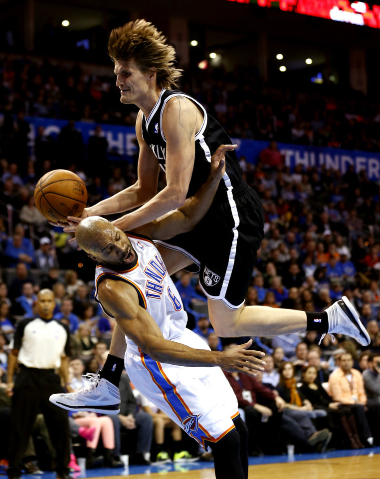 Photo - Thunder's Derek Fisher (6) tries to block the fast break drive of Brooklyn's Andrei Kirilenko in the second half of an NBA basketball game where the Oklahoma City Thunder were defeated 95-93 by the Brooklyn Nets at the Chesapeake Energy Arena in Oklahoma City, on Thursday, Jan. 2, 2014. Photo by Steve Sisney, The Oklahoman