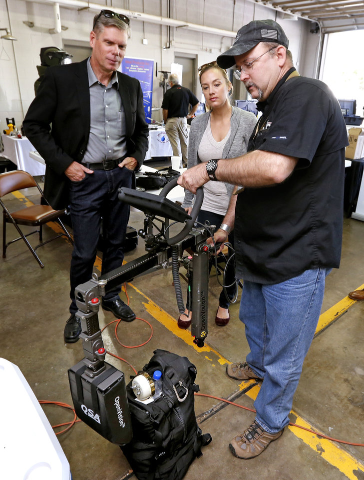 Photo -  OpenVisionTM, a lightweight live video X-ray imaging system specifically designed for hand-held inspection of suspicious objects, is on display at the International Association of Bomb Technicians and Investigators regional training conference. [PHOTO BY STEVE SISNEY, THE OKLAHOMAN]