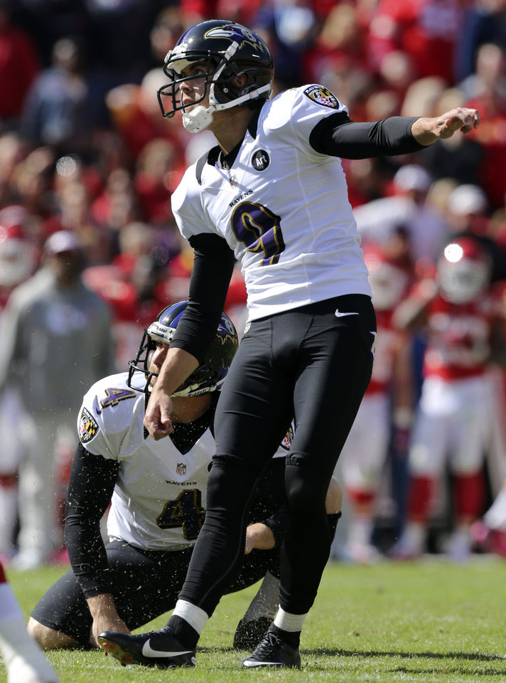 Baltimore Ravens kicker Justin Tucker (9) and holder Sam Koch (4) watch a field goal during the second half of an NFL football game against the Kansas City Chiefs at Arrowhead Stadium in Kansas City, Mo., Sunday, Oct. 7, 2012. (AP Photo/Ed Zurga)