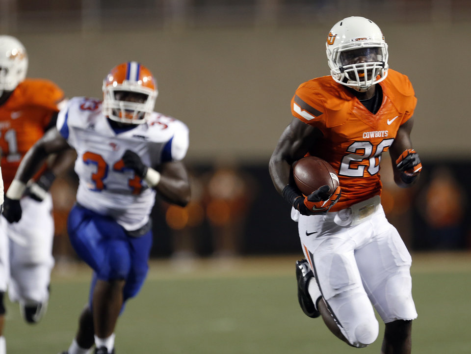 Photo - Oklahoma State's Desmond Roland (26) scores a touchdown as Savannah State's Fredrick Fluker (33) chases him down during a college football game between Oklahoma State University (OSU) and Savannah State University at Boone Pickens Stadium in Stillwater, Okla., Saturday, Sept. 1, 2012. Photo by Sarah Phipps, The Oklahoman