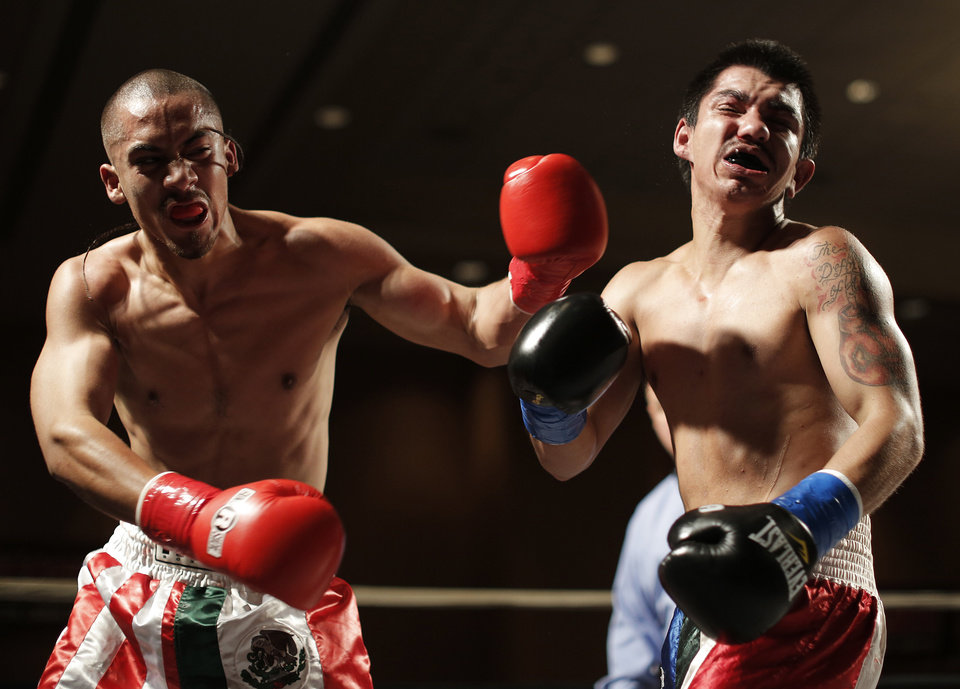 Vincente Hernandez (left), of Oklahoma City, fights Octavio Garay, of Muleshoe, Texas, at the Cox Convention Center in Oklahoma City, Thursday, Sept. 20, 2012.  Photo by Garett Fisbeck, The Oklahoman