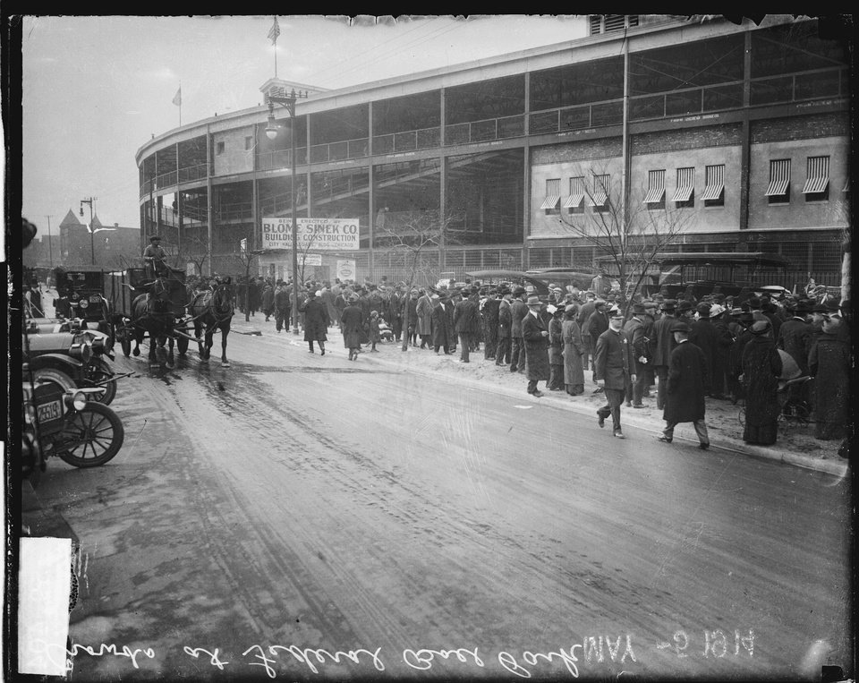 Photo - This May 14, 1914, photo provided by the Chicago History Museum shows crowds lining up along the sidewalk outside Weeghman Park in Chicago. Weeghman Park was home to Charlie Weeghman's Federal League team, the Chicago Whales. The Whales became the Chicago Cubs in 1916. Weeghman Park was renamed Wrigley Field in 1927. The famed ballpark will celebrate it's 100th anniversary on April 23, 2014. (AP Photo/Courtesy of the Chicago History Museum)