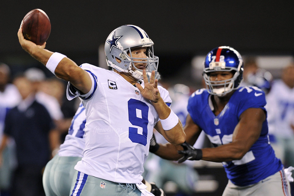 Photo -   Dallas Cowboys quarterback Tony Romo (9) throws a pass during the first half of an NFL football game against the New York Giants, Wednesday, Sept. 5, 2012, in East Rutherford, N.J. (AP Photo/Bill Kostroun)